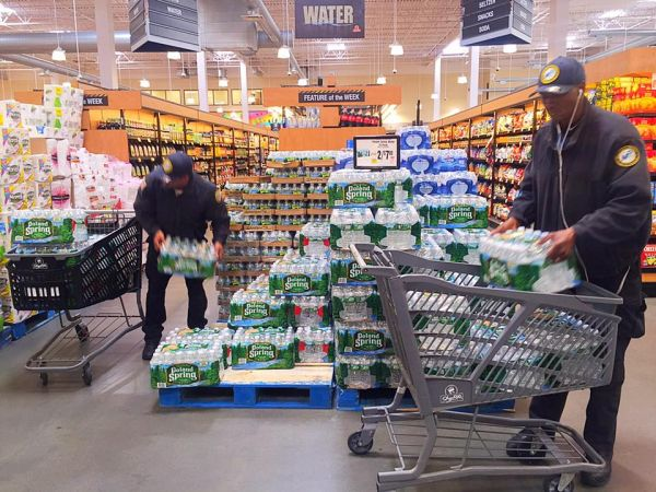 Brigido and Angelo packing in the water to purchase for donation — at ShopRite of Newark -