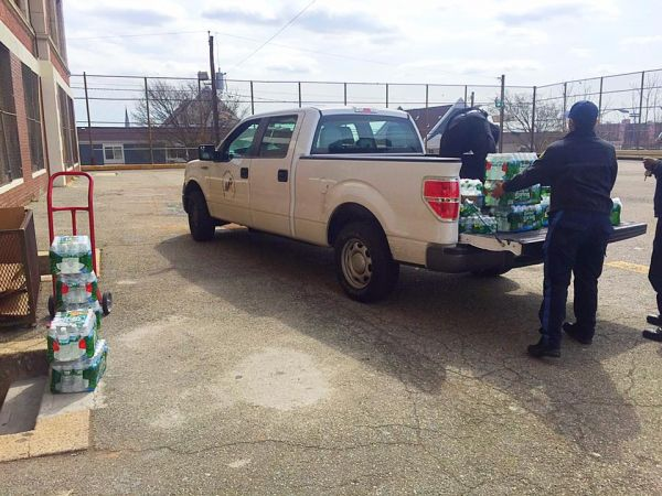 NPA maintenance Officers unloading the water at Cleveland Elementary School — at Cleveland Elementary School.